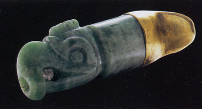 Lip-plug with figure of cox-cox bird