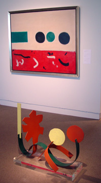 """Petaloid with Two Circles,"" bottom, ""Movement East to West,"" top, both by Adolph Gottlieb"