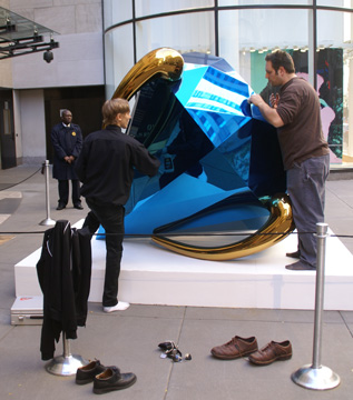 workmen polishing Koons's jewel