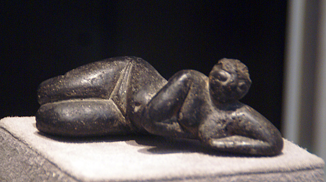 Neolithic stone figure of reclining woman