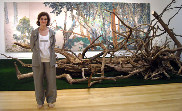 "Marion Bertagna standing next to Yang Jiechang's""Eye of the Storm"""