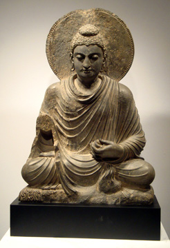 """A Gray Schist Figure of a Seated Buddha"""