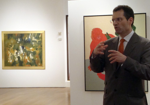 "Hugo Eihe, Christie's Internatinal Director, with Tyeb Mehta's ""Mahishasura"""