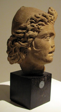 Marble relief head of a dioskouros