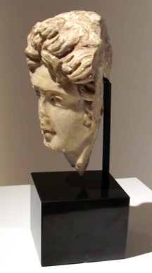 Marble relief head of a youth