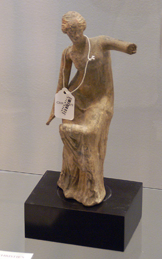 Greek terracotta figure of goddess adjusting her sandal