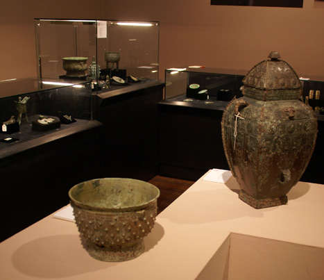 Rare bronze ritual food vessel, yu, left, and fanglei, right