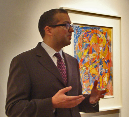 "Robert Manley, Christie's head of evening sale, Contemporary Art, with ""0-9"" by Johns"
