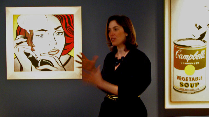 "Amy Cappellazo, International co-head, deputy chairman, Contemporary Art, Christie's, flanked by Lichtenstein's ""Ohhh...Alright"" and Warhol's ""Big Campbell's Soup..."""