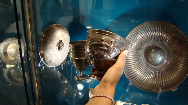 Lot 39, left, a silver cup; center, Lot 33, Roman silver kantharos; right, Lot 58, silver footed bowl with mesomphalos