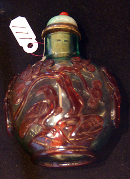 Red overlay on green glass snuff bottle