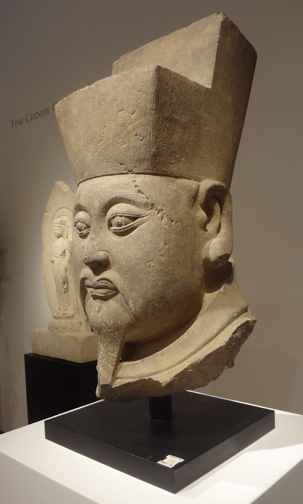 Grey stone head of an official