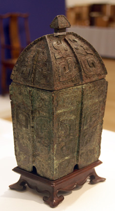Rare archaic bronze ritual vessel and cover (fangyi)