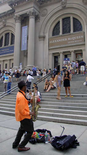 Musician entertains visitors at museum