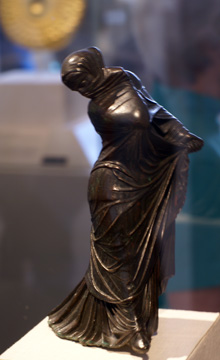 Bronze masked and veiled dancer