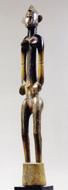 Senufo female rhythm pounder