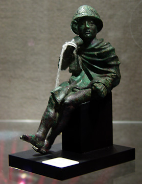 Greek bronze of seated youth