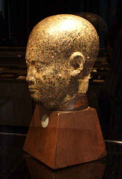 Egyptian red granite head of a man