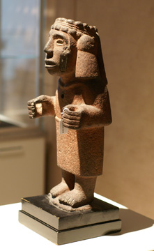 Aztec stone figure of goddess with tasseled headdress