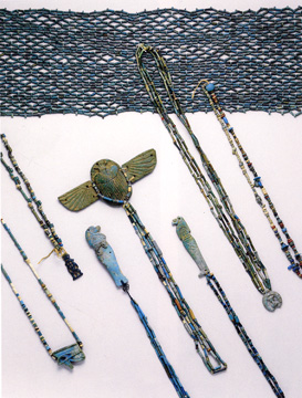 Group of amulets, beads and scarabs