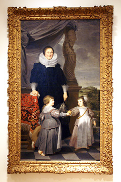 Portrait of a woman and her two children""