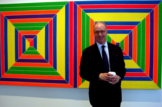 "Anthony Grant in front of Stella's ""Double Mitered Maze"""