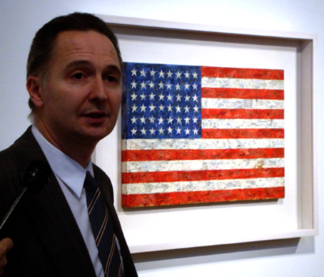 """Brett Gorvy of Christie's with 'Flag' by Johns"