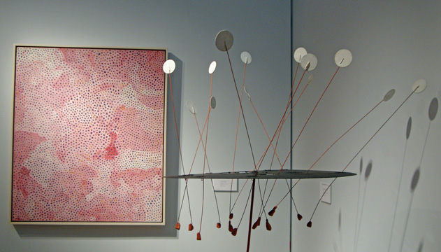"""Untitled (Infinity Nets) by Kusama and ""White Feather, Orange and Red Discs"" by Calder"