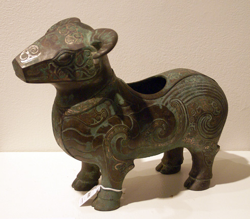 Silver inlaid bronze animal figure