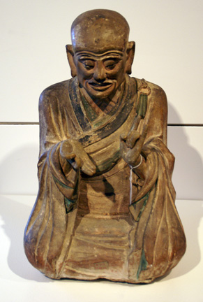 Late Ming pottery figure of seated Luohan