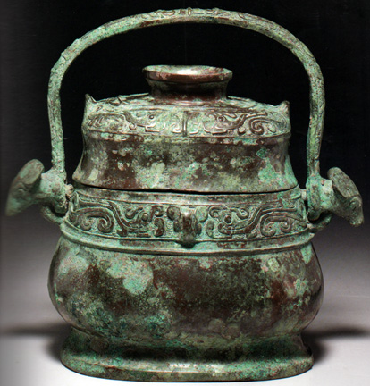 Chinese ritual bronze wine vessel with handle