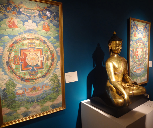 Thangkas and gilt Buddha