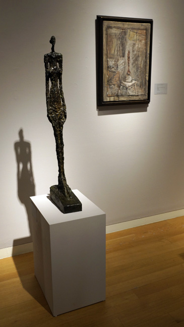 Sculpture of a man and painting by Giacometti