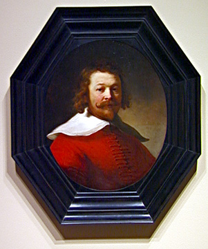 Portrait of man in red doublet by Rembrandt