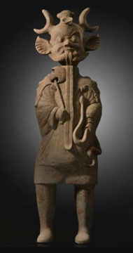 Han dynasty pottery figure of a shaman