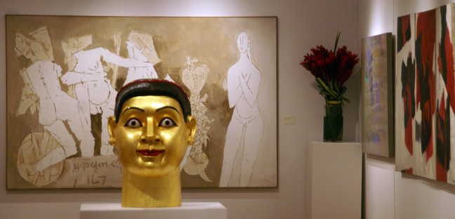 Untitled work by Husain in background and untitled sculpture by Ravinder Reddy foreground