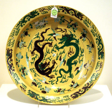 Yellow-ground biscuit charger with Kangxi mark and period