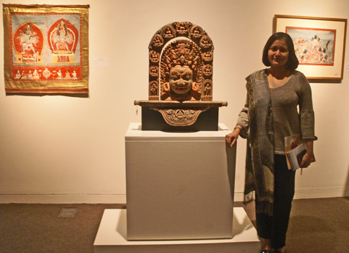 Anuradha Ghosh-Mazumdar in front of 17th Century Nepalese wood shine